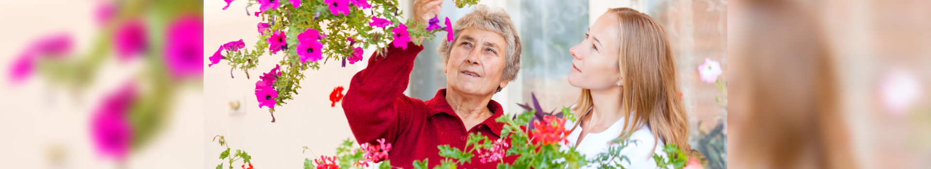 caregiver helping old woman in gardening