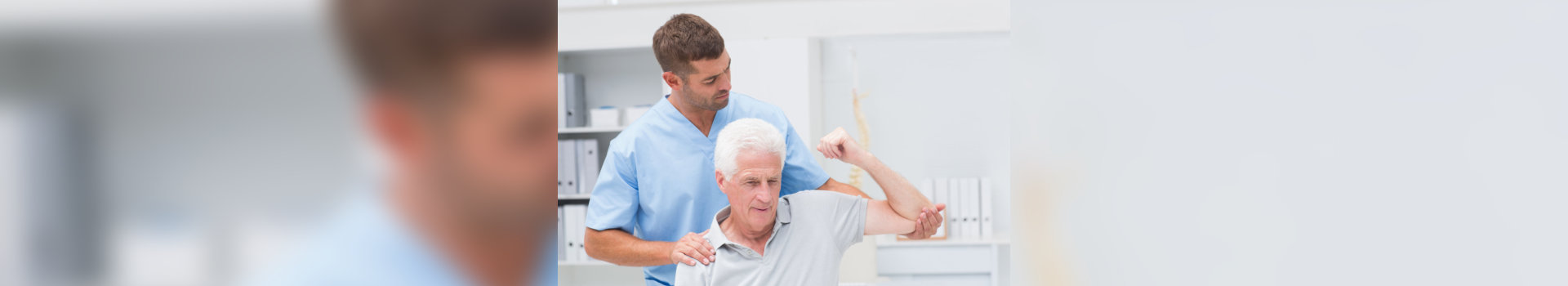 old man having his physical therapy with the assistance of caregiver
